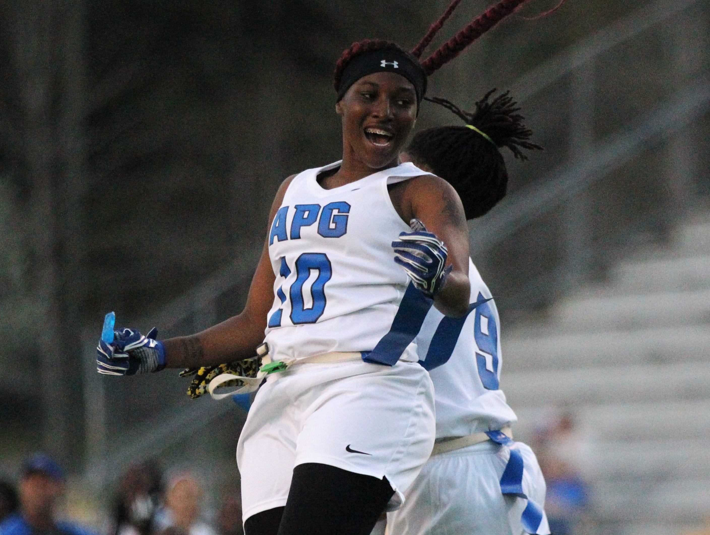 Godby's Kiara Byrd (10) and Toni McClain celebrate a touchdown as Godby's flag football team beat Lincoln 25-6 at Gene Cox Stadium on March 14, 2019.