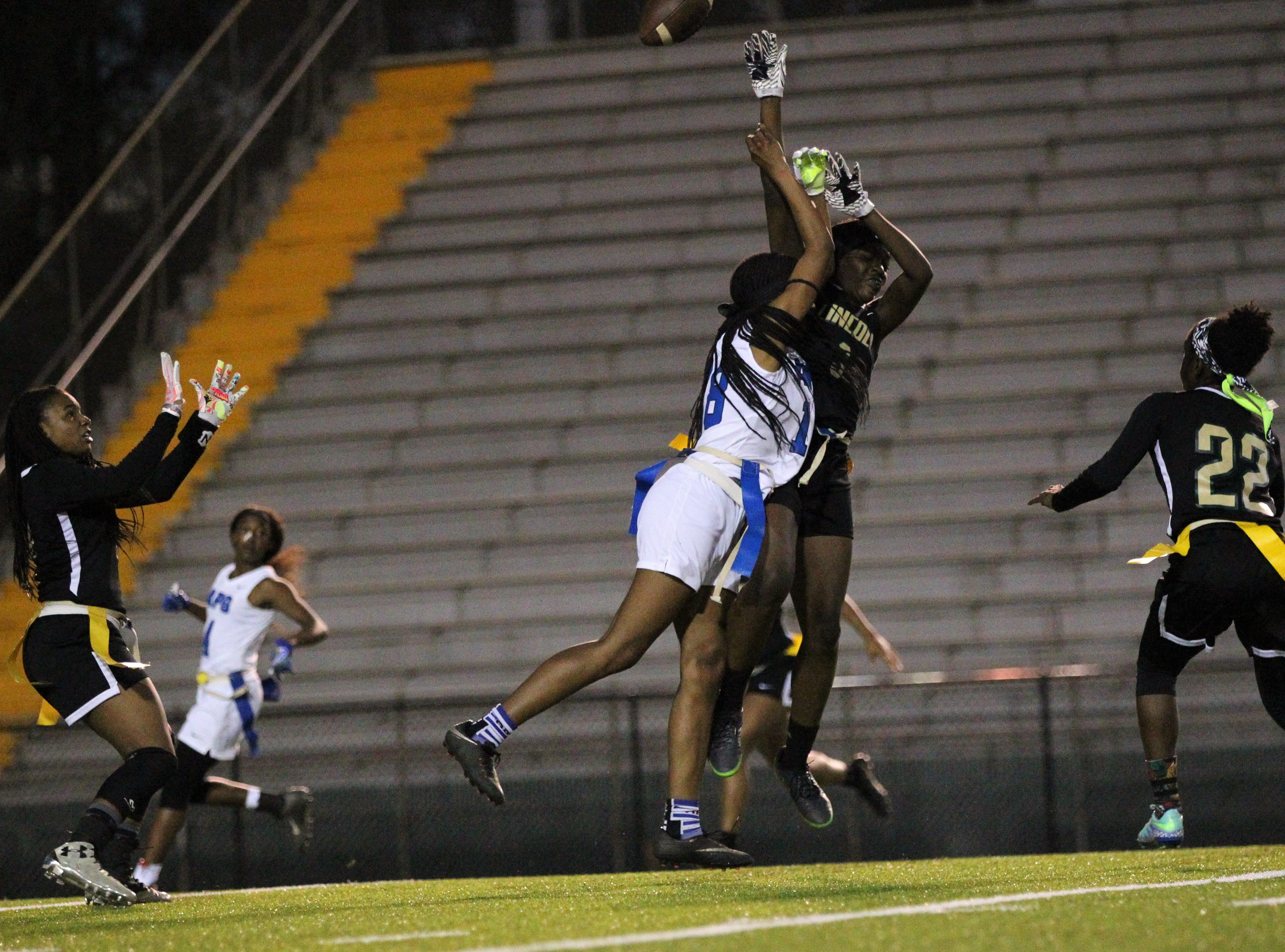 Lincoln breaks up a deep pass that results in an interception as Godby's flag football team beat Lincoln 25-6 at Gene Cox Stadium on March 14, 2019.