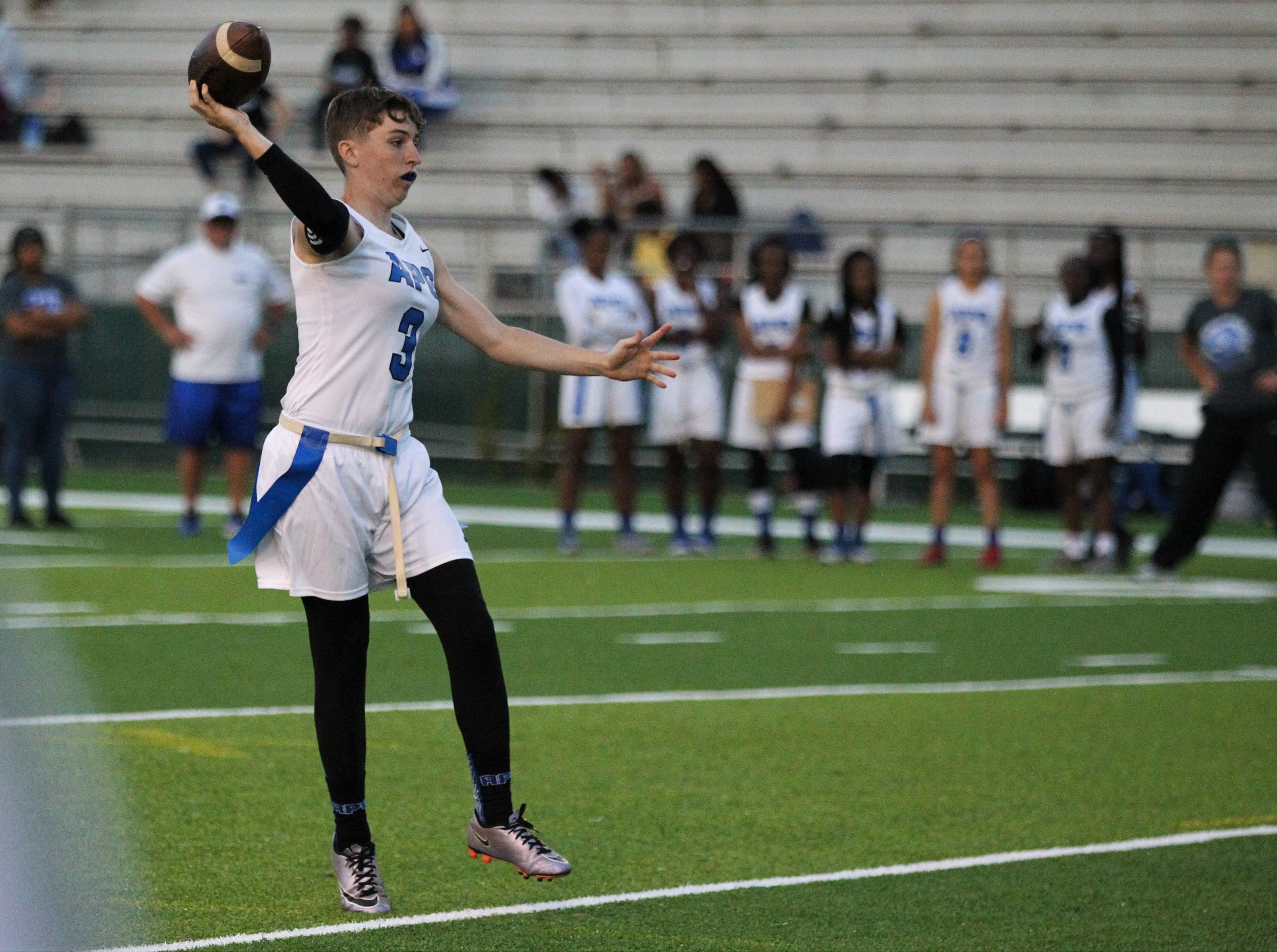 Godby senior quarterback Kaylene Colburn throws a pass as the Cougars' flag football team beat Lincoln 25-6 at Gene Cox Stadium on March 14, 2019.