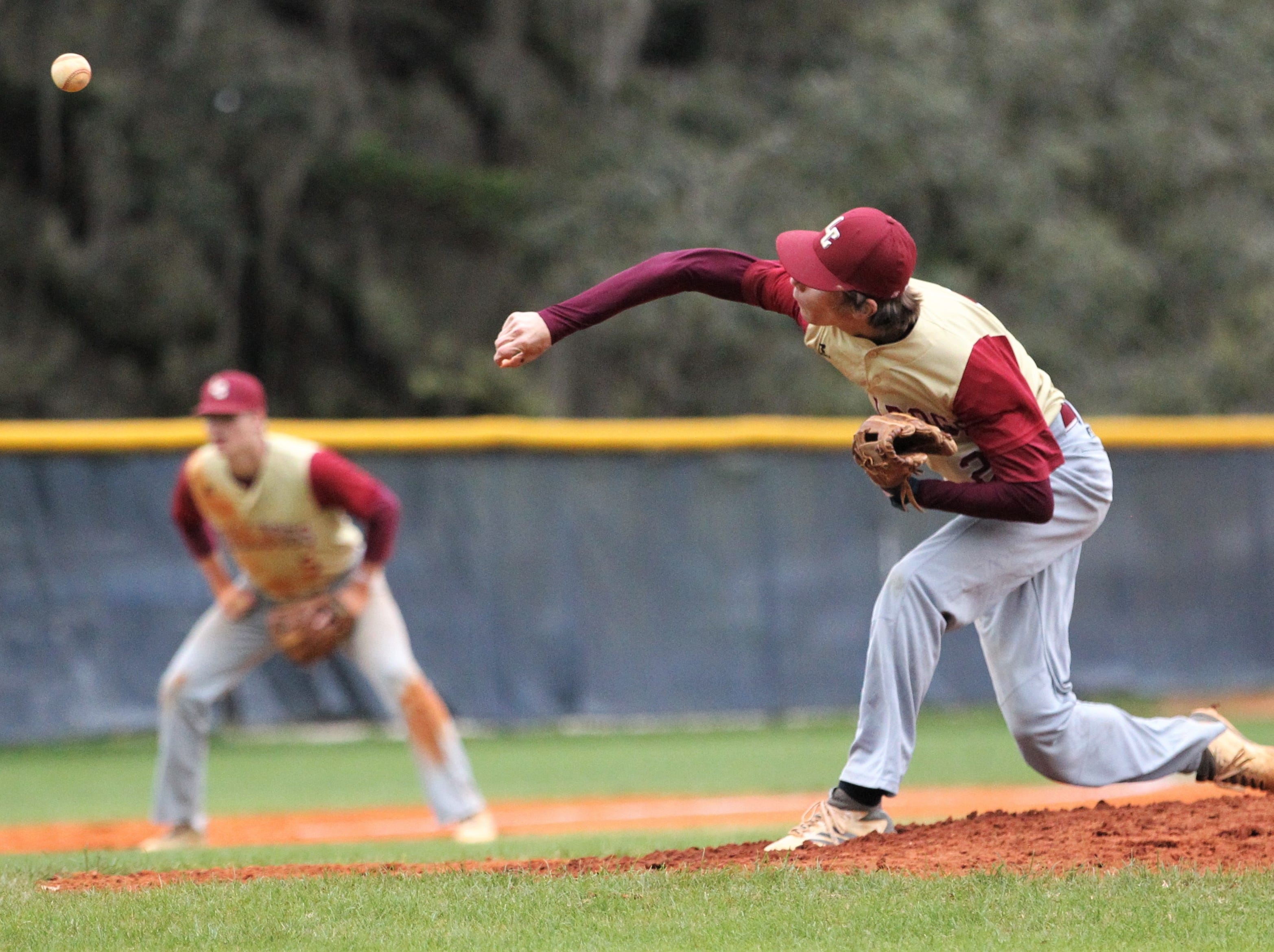 Liberty County senior Brent Fant pitches as Liberty County's baseball team went on the road to beat Maclay 8-2 on Saturday, March 16, 2019. The Bulldogs played their first game following their head coach Corey Crum's tragic death six days ago.