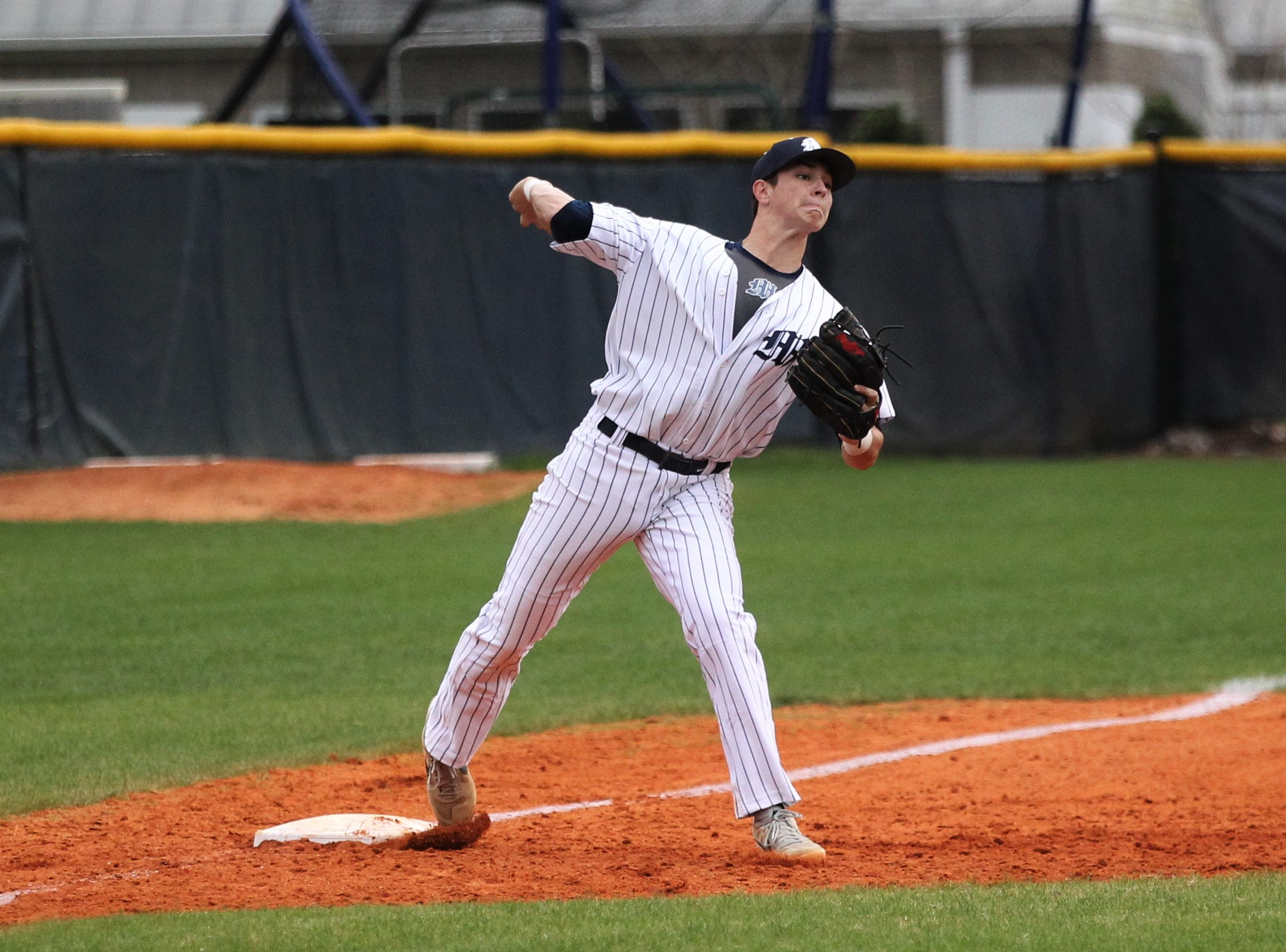 Maclay third baseman Jason Norris steps on third for an out and throws to first as Liberty County's baseball team went on the road to beat Maclay 8-2 on Saturday, March 16, 2019. The Bulldogs played their first game following their head coach Corey Crum's tragic death six days ago.