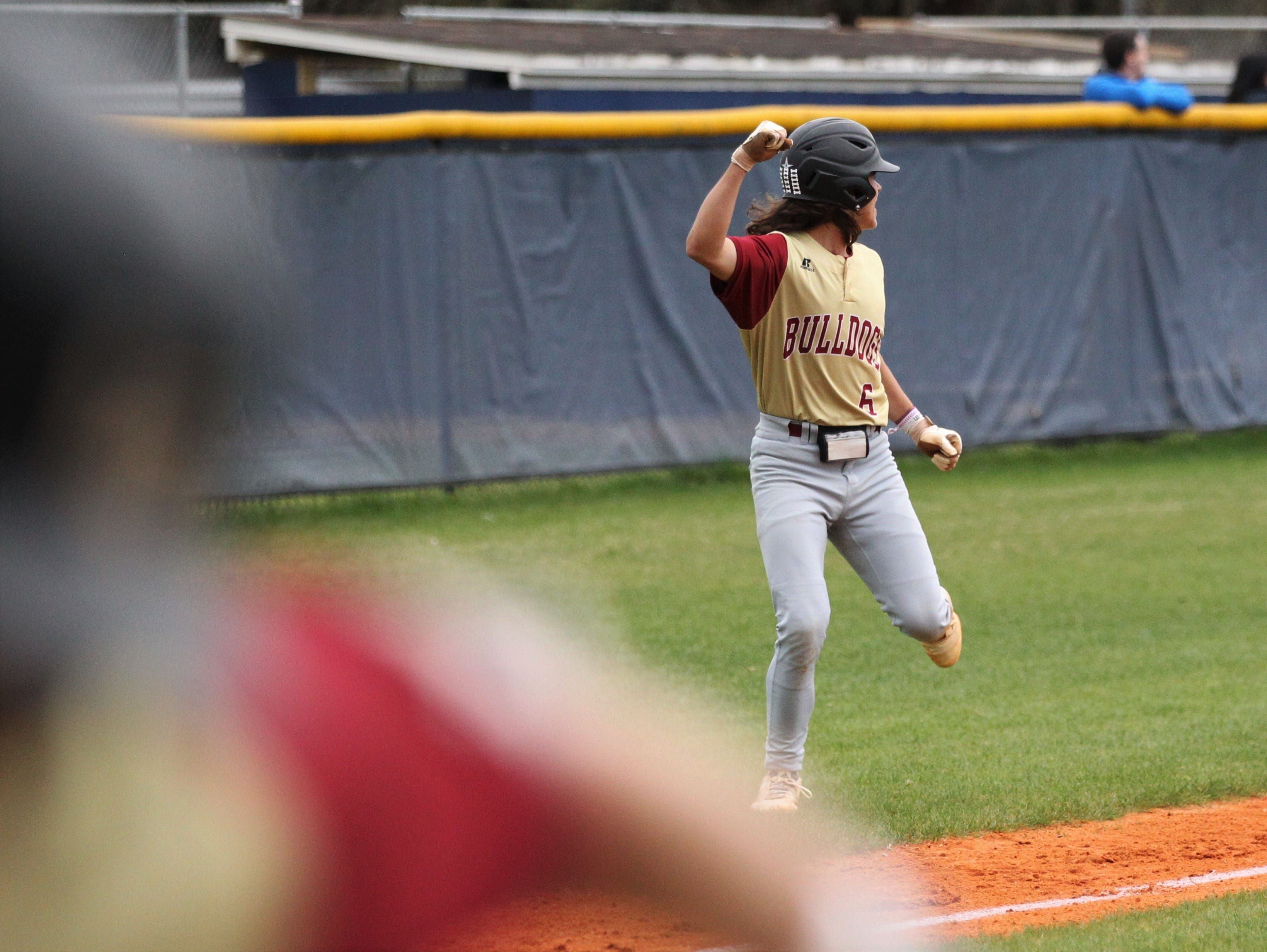 Liberty County's Charlie Burns watches as Brice Dillmore's home run hits the scoreboard as Liberty County's baseball team went on the road to beat Maclay 8-2 on Saturday, March 16, 2019. The Bulldogs played their first game following their head coach Corey Crum's tragic death six days ago.