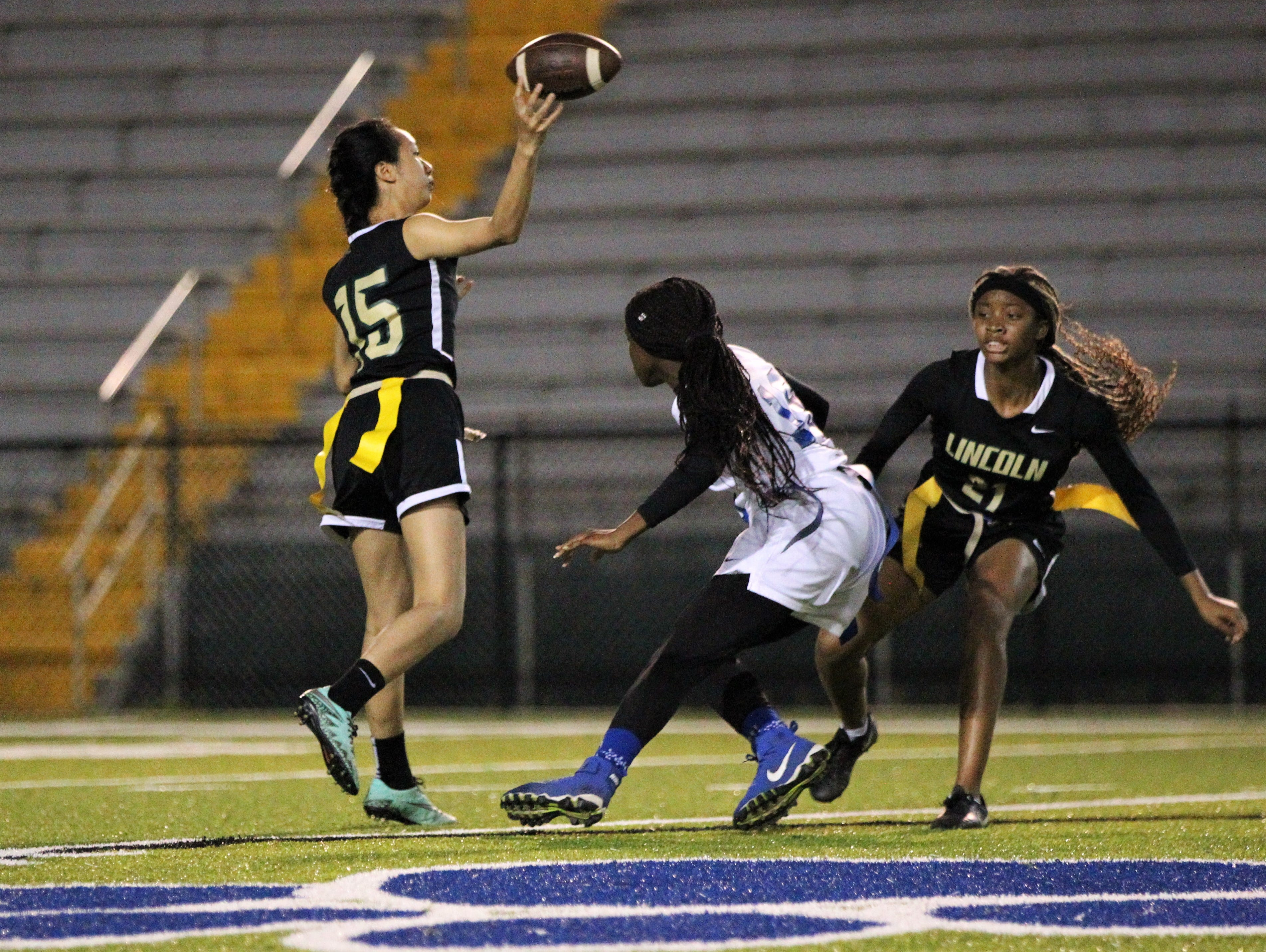 Lincoln quarterback Ivy Zheng throws a pass as Godby's flag football team beat Lincoln 25-6 at Gene Cox Stadium on March 14, 2019.