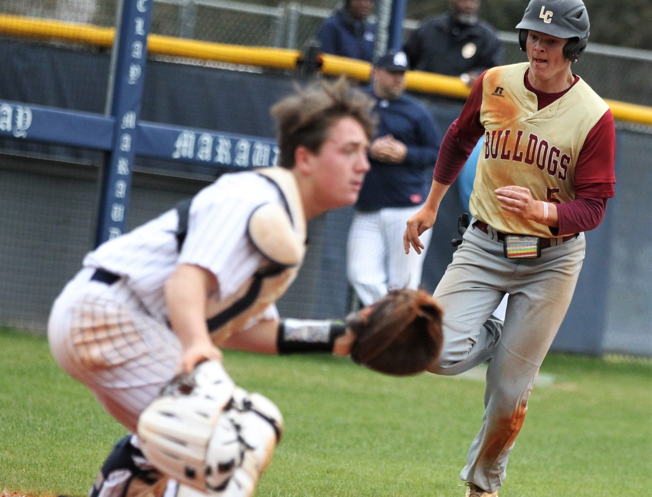 Liberty County's Brice Dillmore races home to score on a fielder's choice as Liberty County's baseball team went on the road to beat Maclay 8-2 on Saturday, March 16, 2019. The Bulldogs played their first game following their head coach Corey Crum's tragic death six days ago.