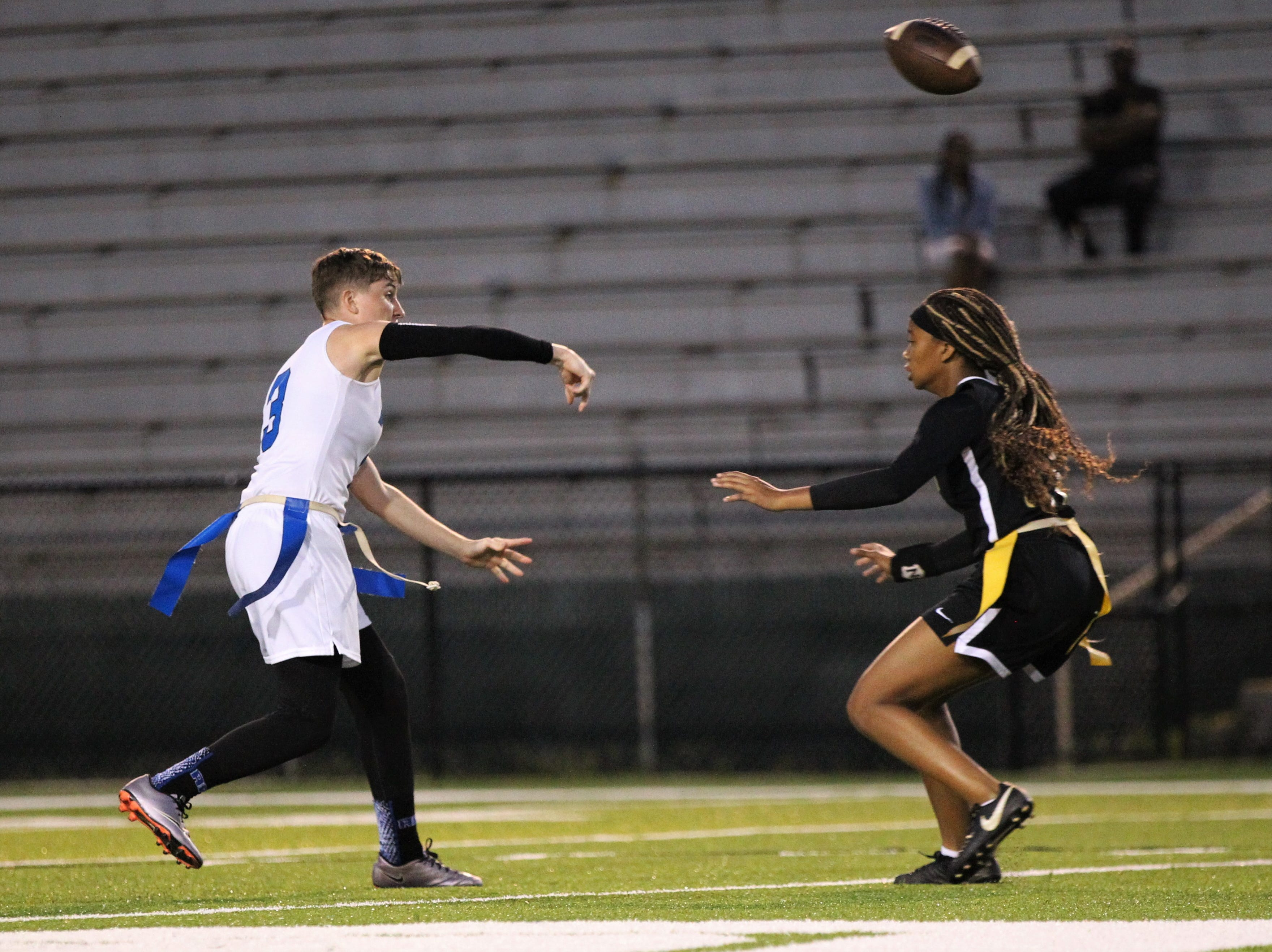 Godby senior quarterback Kaylene Colburn makes a pass as Godby's flag football team beat Lincoln 25-6 at Gene Cox Stadium on March 14, 2019.