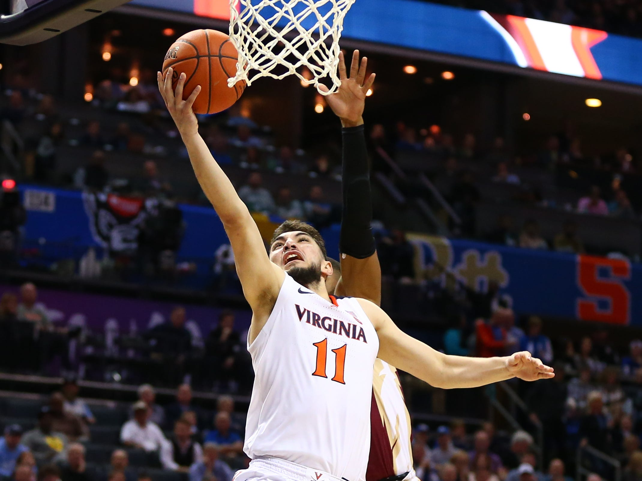 Mar 15, 2019; Charlotte, NC, USA; Virginia Cavaliers guard Ty Jerome (11) shoots against Florida State Seminoles guard M.J. Walker (23) in the second half in the ACC conference tournament at Spectrum Center. Mandatory Credit: Jeremy Brevard-USA TODAY Sports