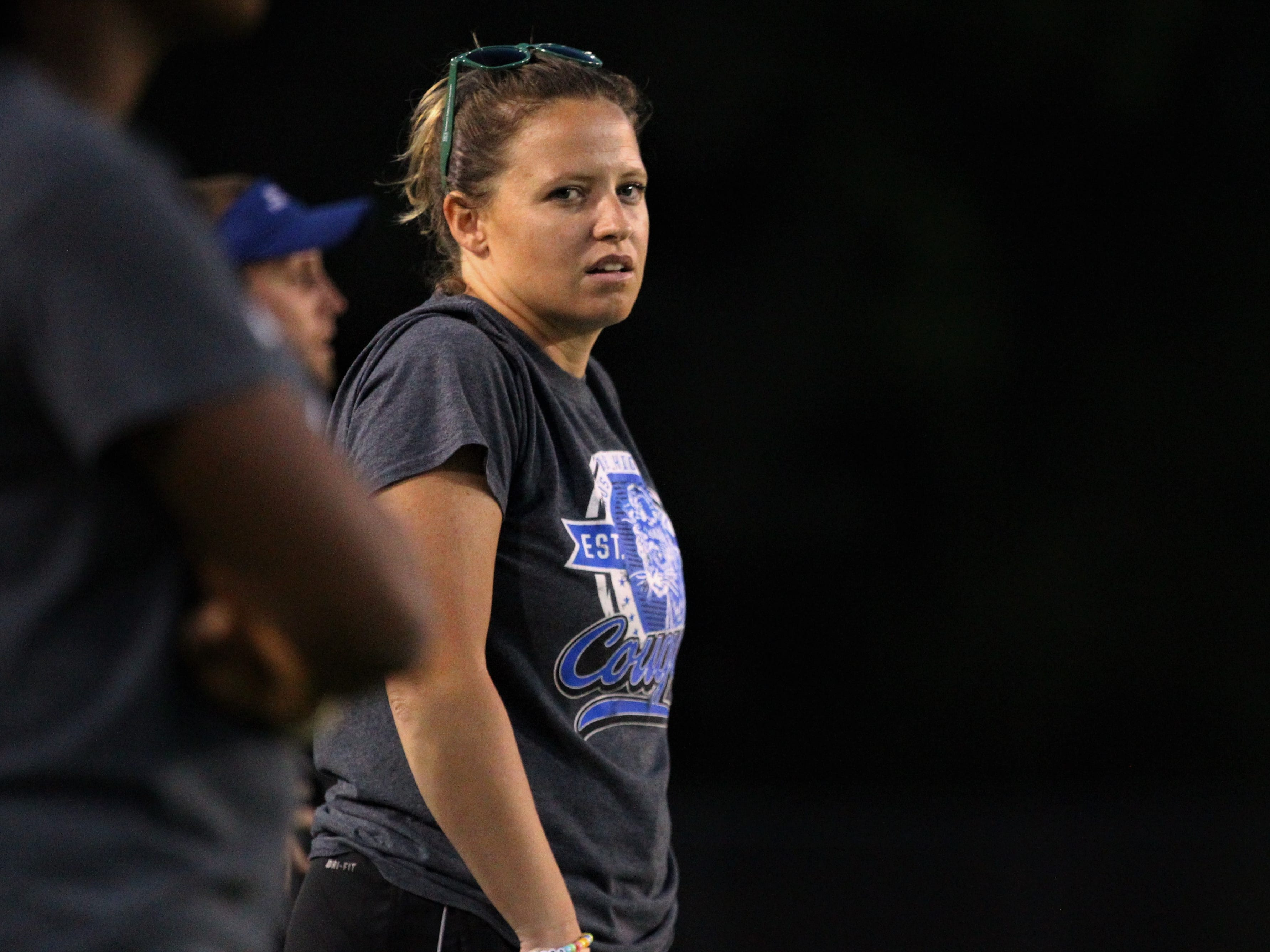 Godby flag football coach Chelsea Parmer walks the sidelines as the Cougars beat Lincoln 25-6 at Gene Cox Stadium on March 14, 2019.
