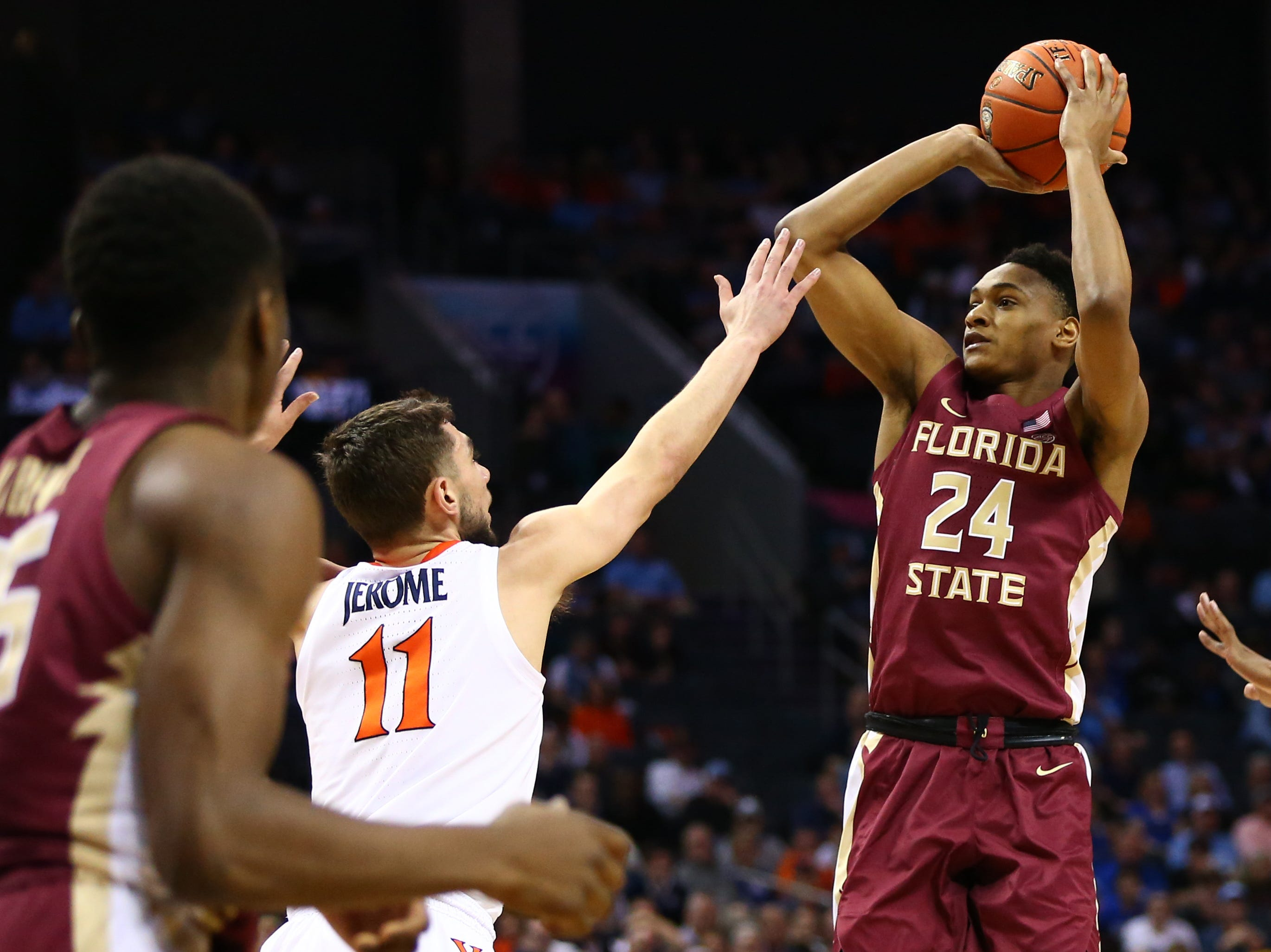 Mar 15, 2019; Charlotte, NC, USA; Florida State Seminoles guard Devin Vassell (24) shoots the ball against Virginia Cavaliers guard Ty Jerome (11) in the first half in the ACC conference tournament at Spectrum Center. Mandatory Credit: Jeremy Brevard-USA TODAY Sports