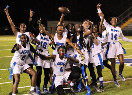Godby's flag football team celebrates a 25-6 win over Lincoln at Gene Cox Stadium on March 14, 2019.