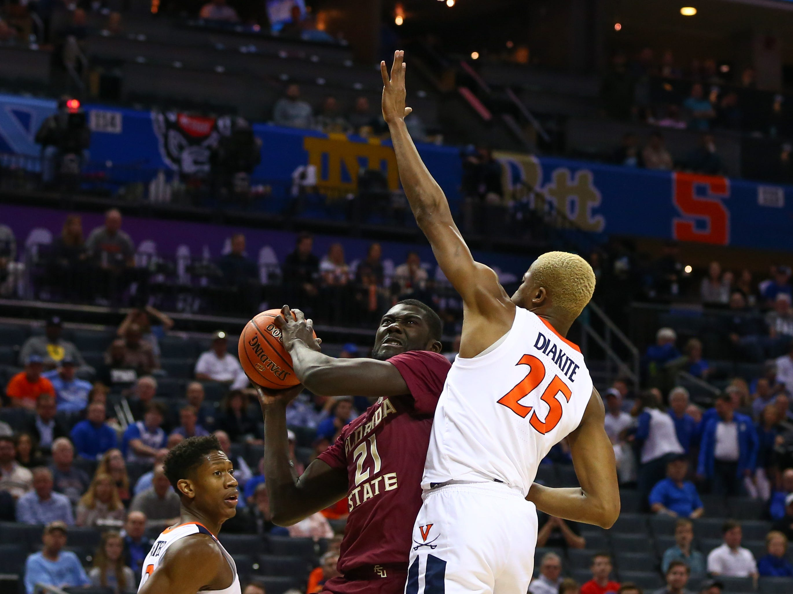Mar 15, 2019; Charlotte, NC, USA; Florida State Seminoles center Christ Koumadje (21) shoots the ball against Virginia Cavaliers forward Mamadi Diakite (25) in the first half in the ACC conference tournament at Spectrum Center. Mandatory Credit: Jeremy Brevard-USA TODAY Sports