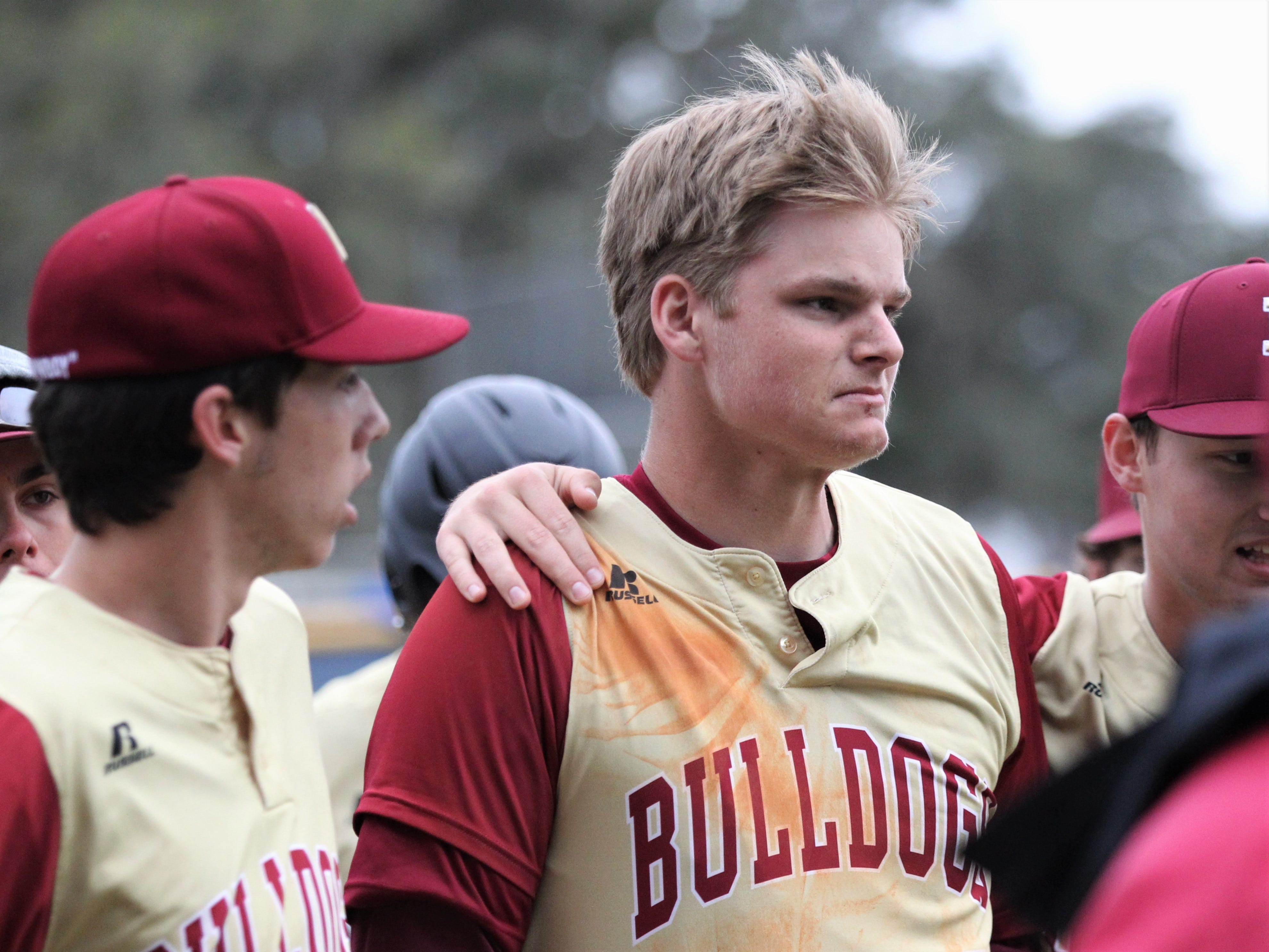 Liberty County senior Brice Dillmore holds in his emotion after a three-run home run as the Bulldogs went on the road to beat Maclay 8-2 on Saturday, March 16, 2019. Liberty County's baseball coach Corey Crum died a week earlier in an accident at the school.