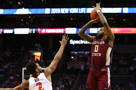 Mar 15, 2019; Charlotte, NC, USA; Florida State Seminoles forward Phil Cofer (0) shoots the ball over Virginia Cavaliers guard Braxton Key (2) in the first half in the ACC conference tournament at Spectrum Center. Mandatory Credit: Jeremy Brevard-USA TODAY Sports