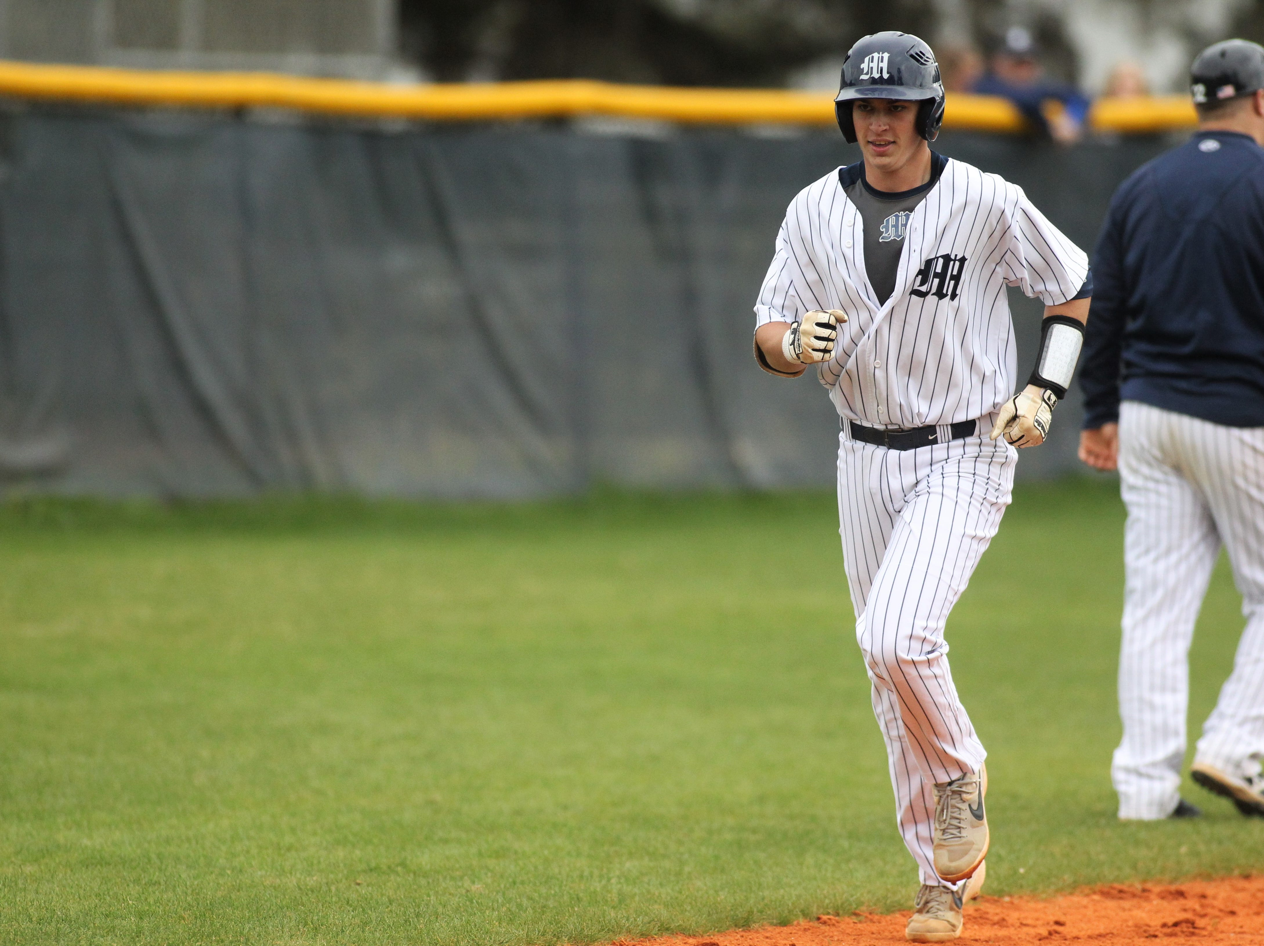 Maclay senior Jason Norris trots home after hitting a two-run home run as Liberty County's baseball team went on the road to beat Maclay 8-2 on Saturday, March 16, 2019. The Bulldogs played their first game following their head coach Corey Crum's tragic death six days ago.