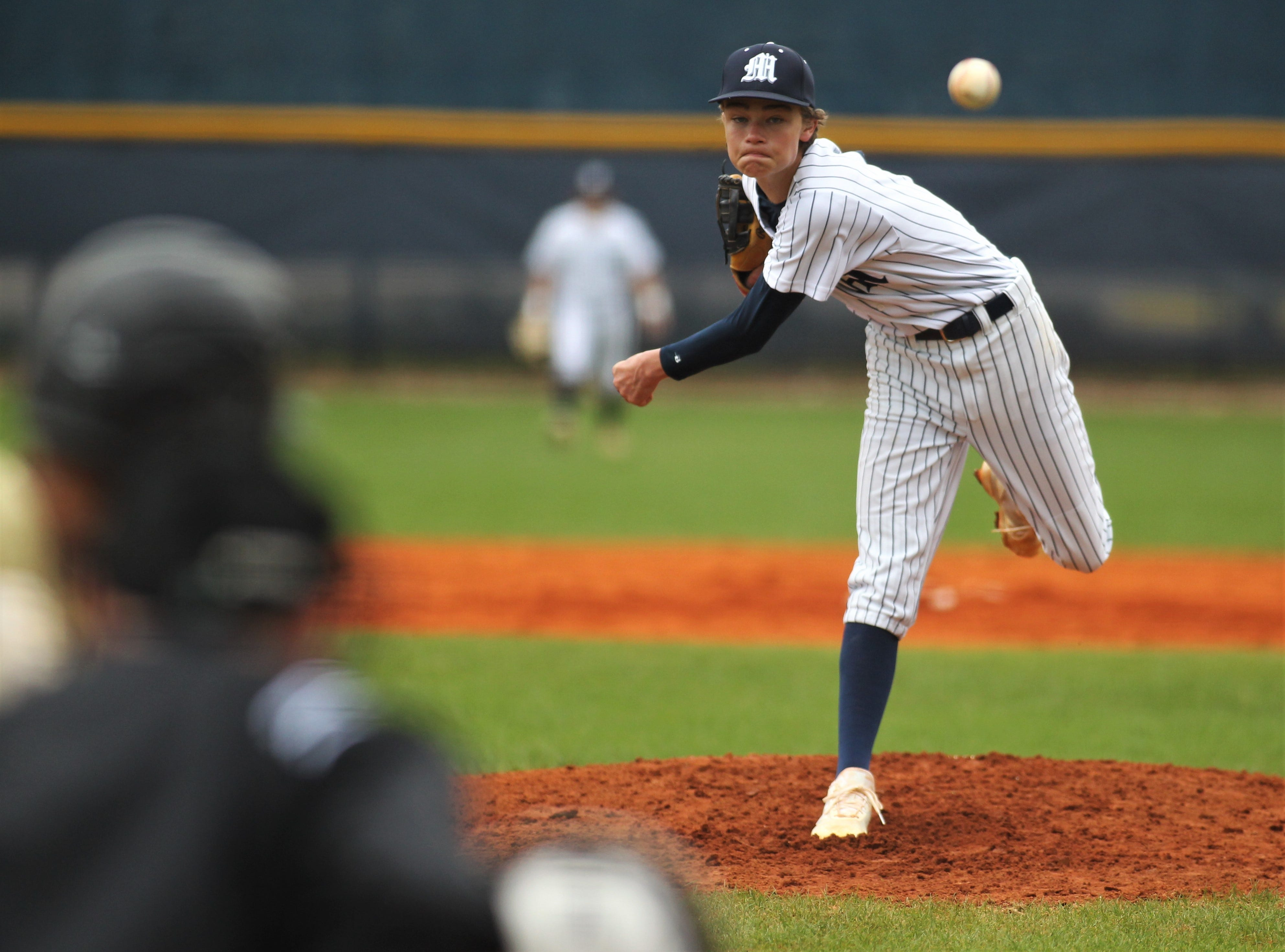 Maclay's Ryker Chavis throws a pitch as Liberty County's baseball team went on the road to beat Maclay 8-2 on Saturday, March 16, 2019. The Bulldogs played their first game following their head coach Corey Crum's tragic death six days ago.