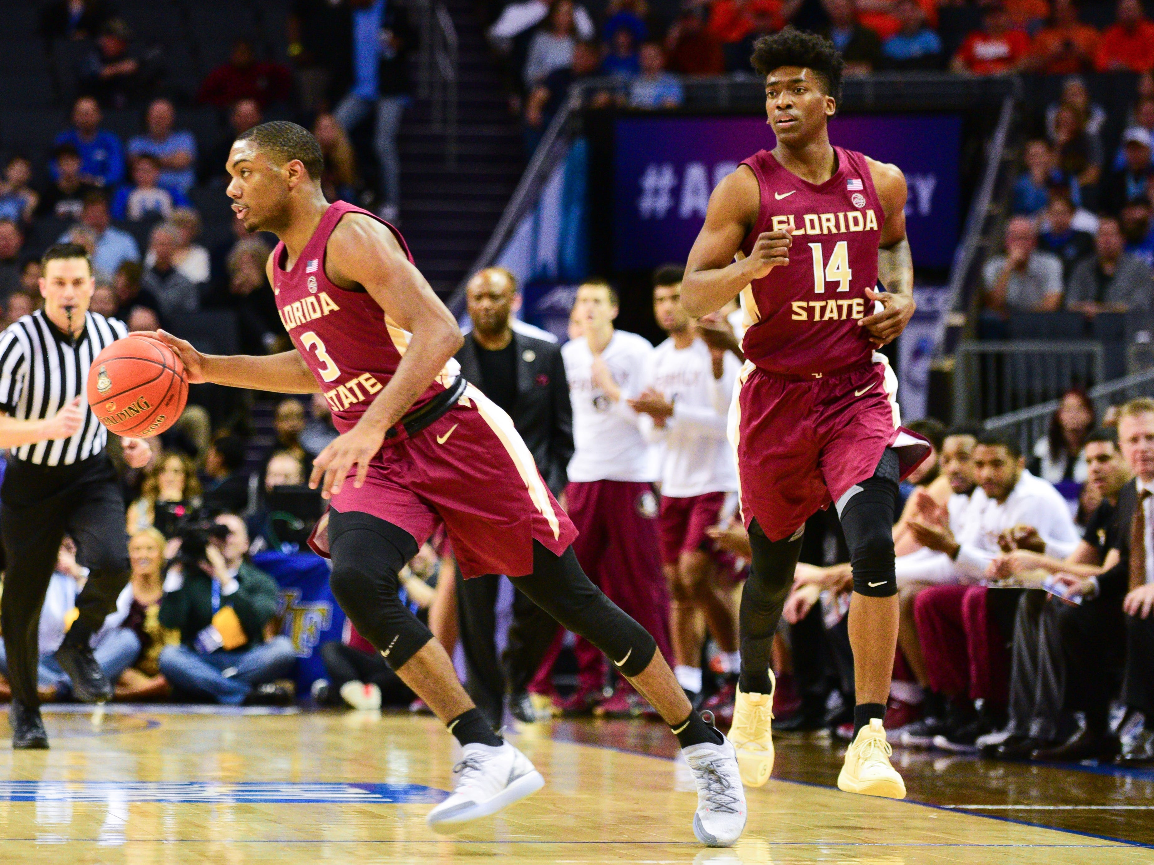 Florida State junior guard Trent Forrestt, left, and senior guard Terance Mann, right, charge the court together during the first half of the ACC Tournament Semifinals at the Spectrum Center in Charlotte on Friday.