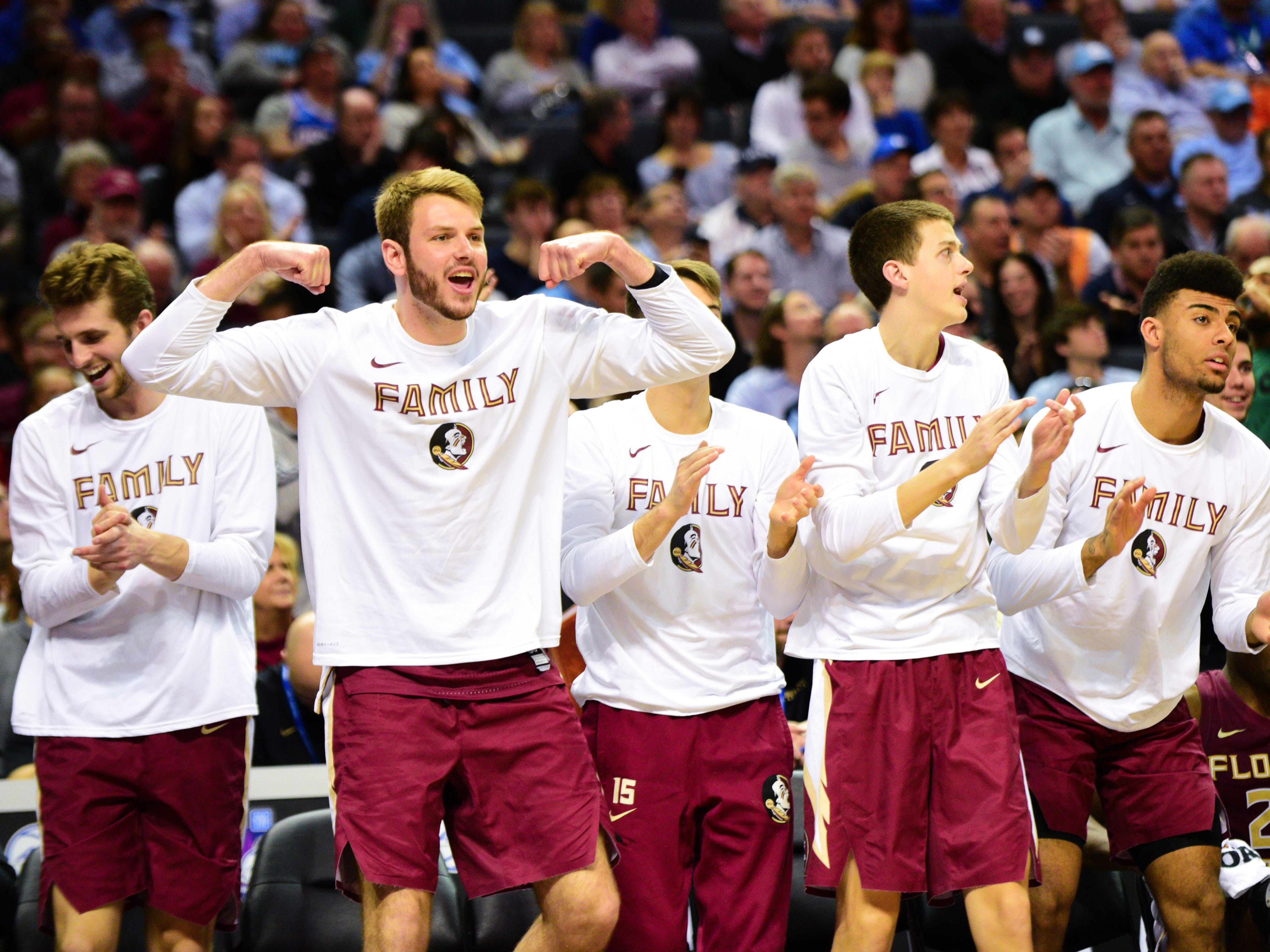 The Florida State bench celebrates taking a large lead during the second half of the ACC Tournament Semifinals at the Spectrum Center in Charlotte on Friday.