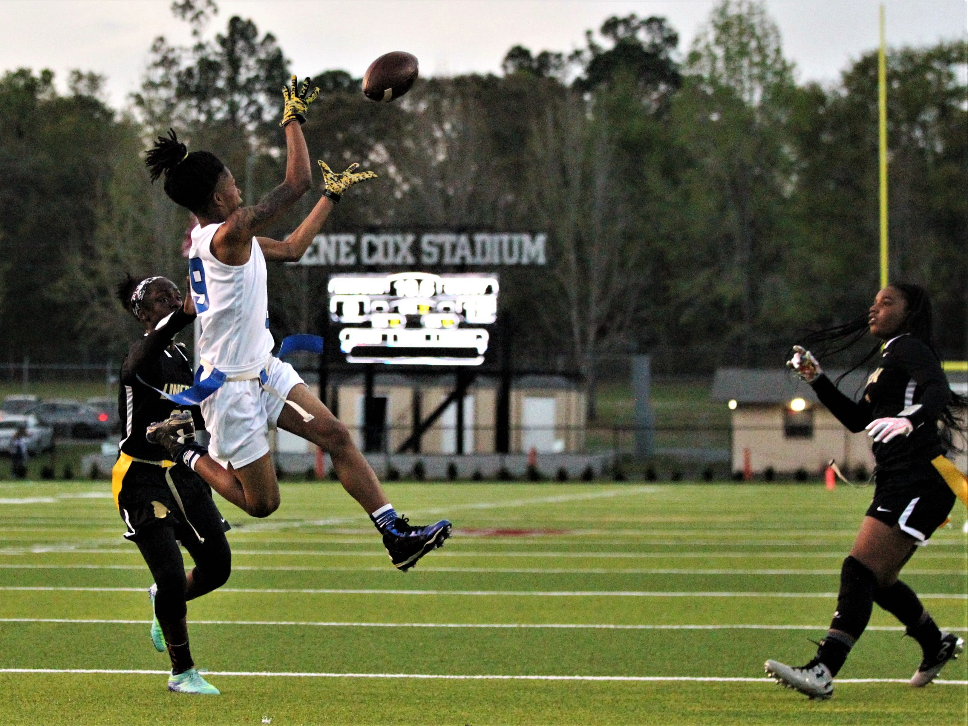 Godby sophomore receiver Toni McClain makes a leaping 13-yard touchdown catch down the seam as Godby's flag football team beat Lincoln 25-6 at Gene Cox Stadium on March 14, 2019.