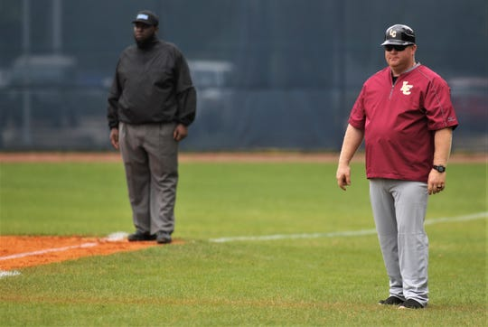 Liberty County assistant coach Randall Crum, whose brother Corey Crum died last Sunday in an accident at the school, served as the Bulldogs' first base coach as Liberty County went on the road to beat Maclay 8-2 on Saturday, March 16, 2019.