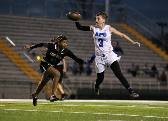 Godby senior quarterback Kaylene Colburn escapes a pass rush and flips a pass just in time as the Cougars' flag football team beat Lincoln 25-6 at Gene Cox Stadium on March 14, 2019.