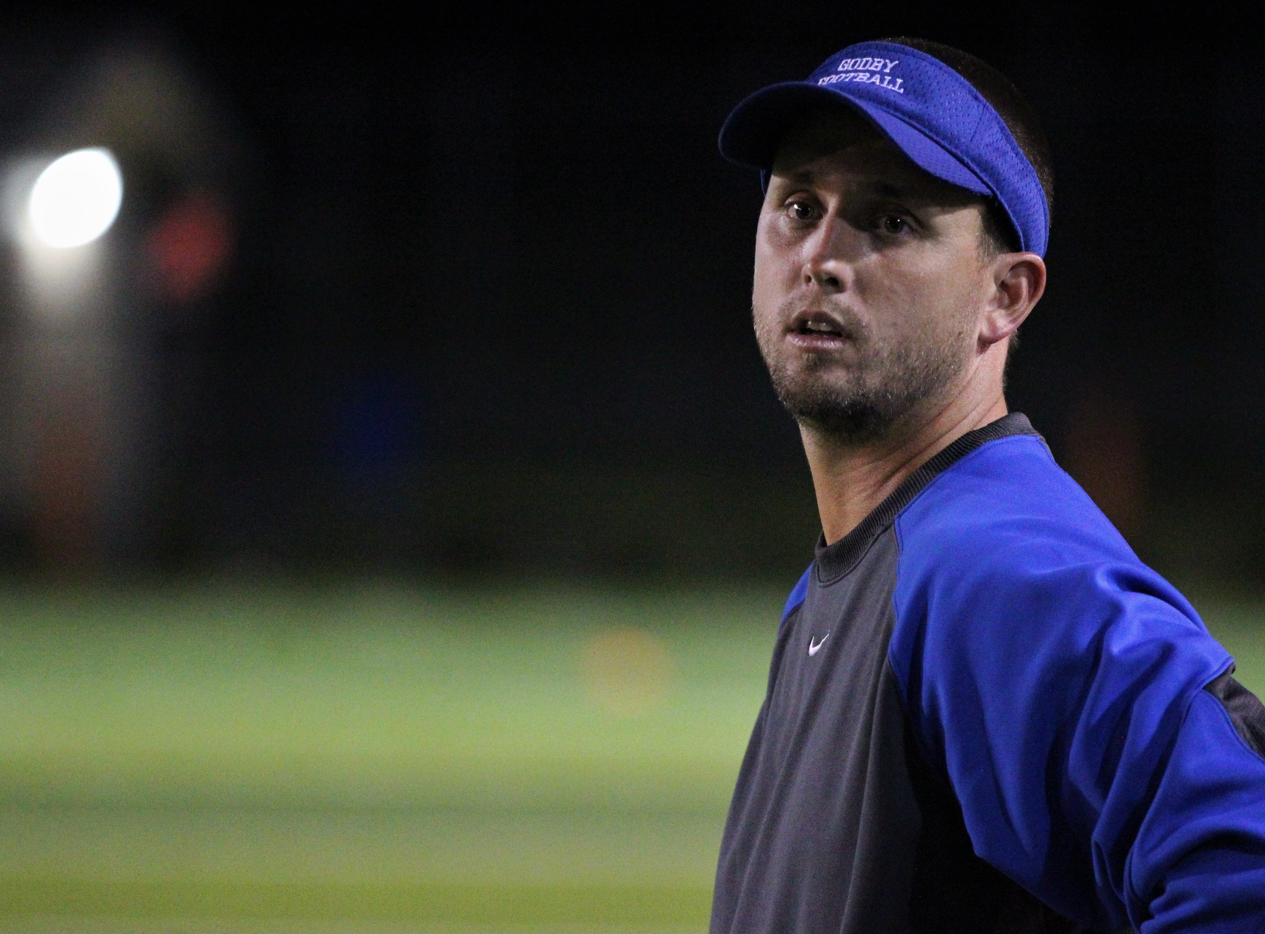 Godby offensive coordinator Ricky Hufty watches as Godby's flag football team beat Lincoln 25-6 at Gene Cox Stadium on March 14, 2019.