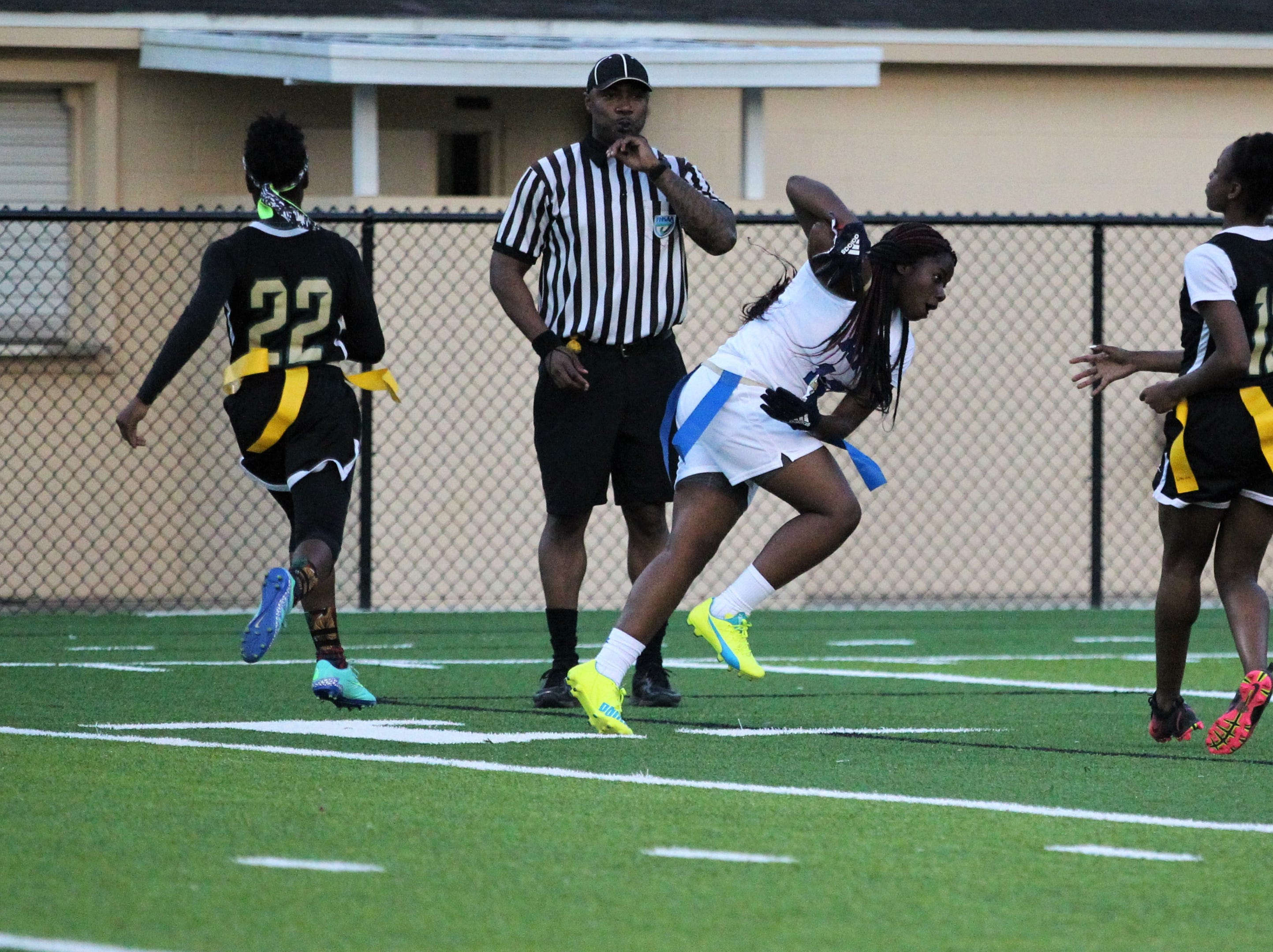 Godby senior Essence Nobles makes a touchdown catch as the Cougars' flag football team beat Lincoln 25-6 at Gene Cox Stadium on March 14, 2019.