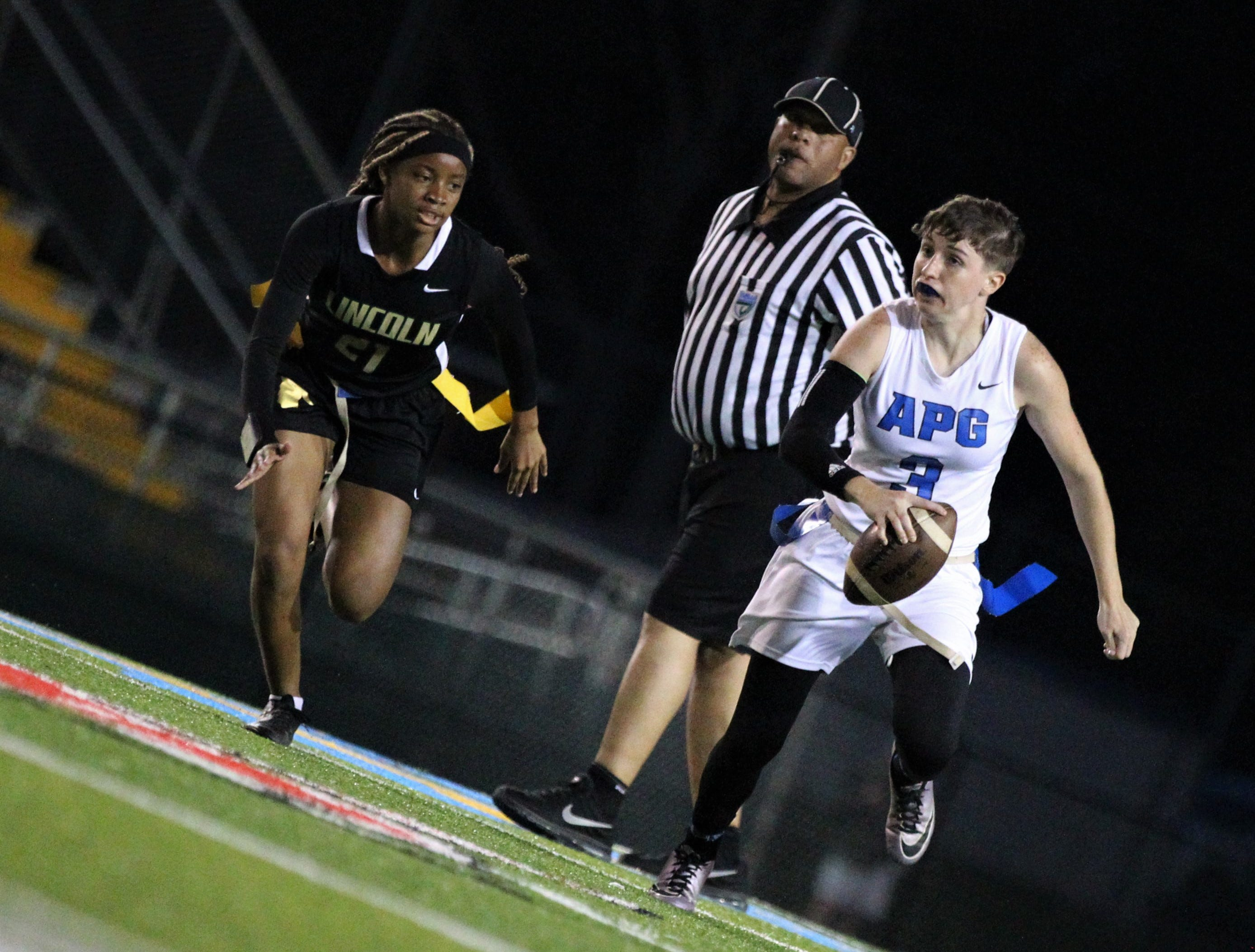 Godby senior quarterback Kaylene Colburn evades a pass rush as Godby's flag football team beat Lincoln 25-6 at Gene Cox Stadium on March 14, 2019.
