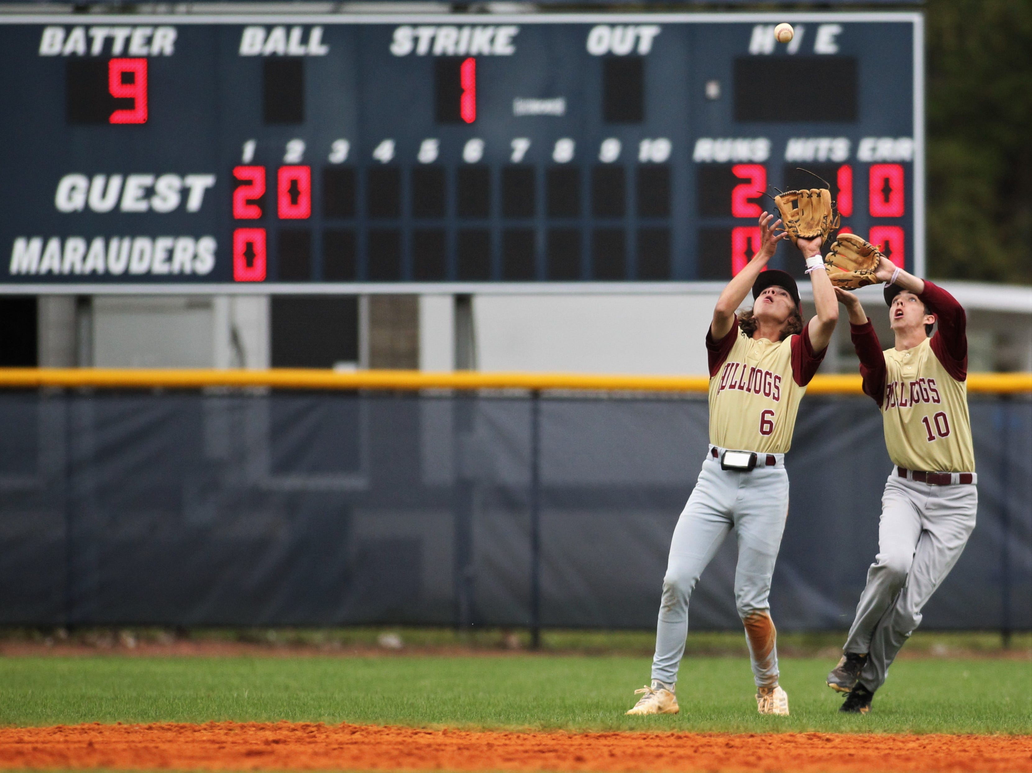 Liberty County shortstop Charlie Burns and center fielder Aiden Hirsch collide on a pop fly but Burns made the out as Liberty County's baseball team went on the road to beat Maclay 8-2 on Saturday, March 16, 2019. The Bulldogs played their first game following their head coach Corey Crum's tragic death six days ago.