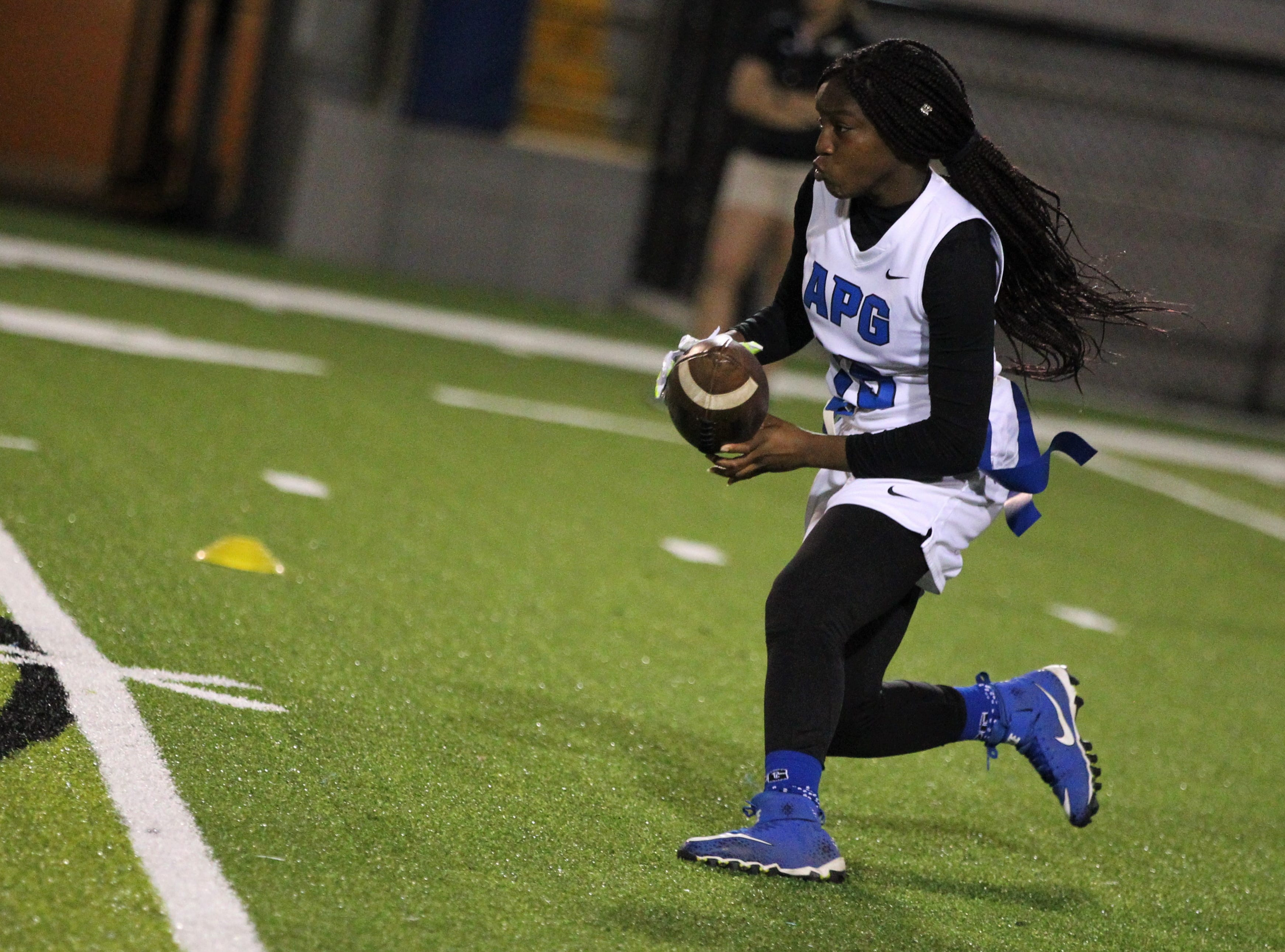 Godby's Essence Nobles runs upfield after a catch as Godby's flag football team beat Lincoln 25-6 at Gene Cox Stadium on March 14, 2019.