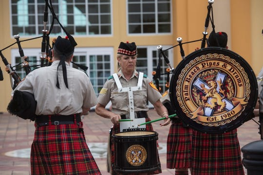 Sheila Mills, of West Palm Beach, plays the snare drum as the Palm Beach Pipes & Drums perform for a crowd Saturday, March 16, 2019, during the St. Patrick's Day Festival at the Port St. Lucie Civic Center. The Friendly Sons & Daughters of Ireland and the city of Port St. Lucie presented the two-day event that featured a parade, carnival rides, traditional Irish food and drink, live music and the first Miss Irish Rose pageant.