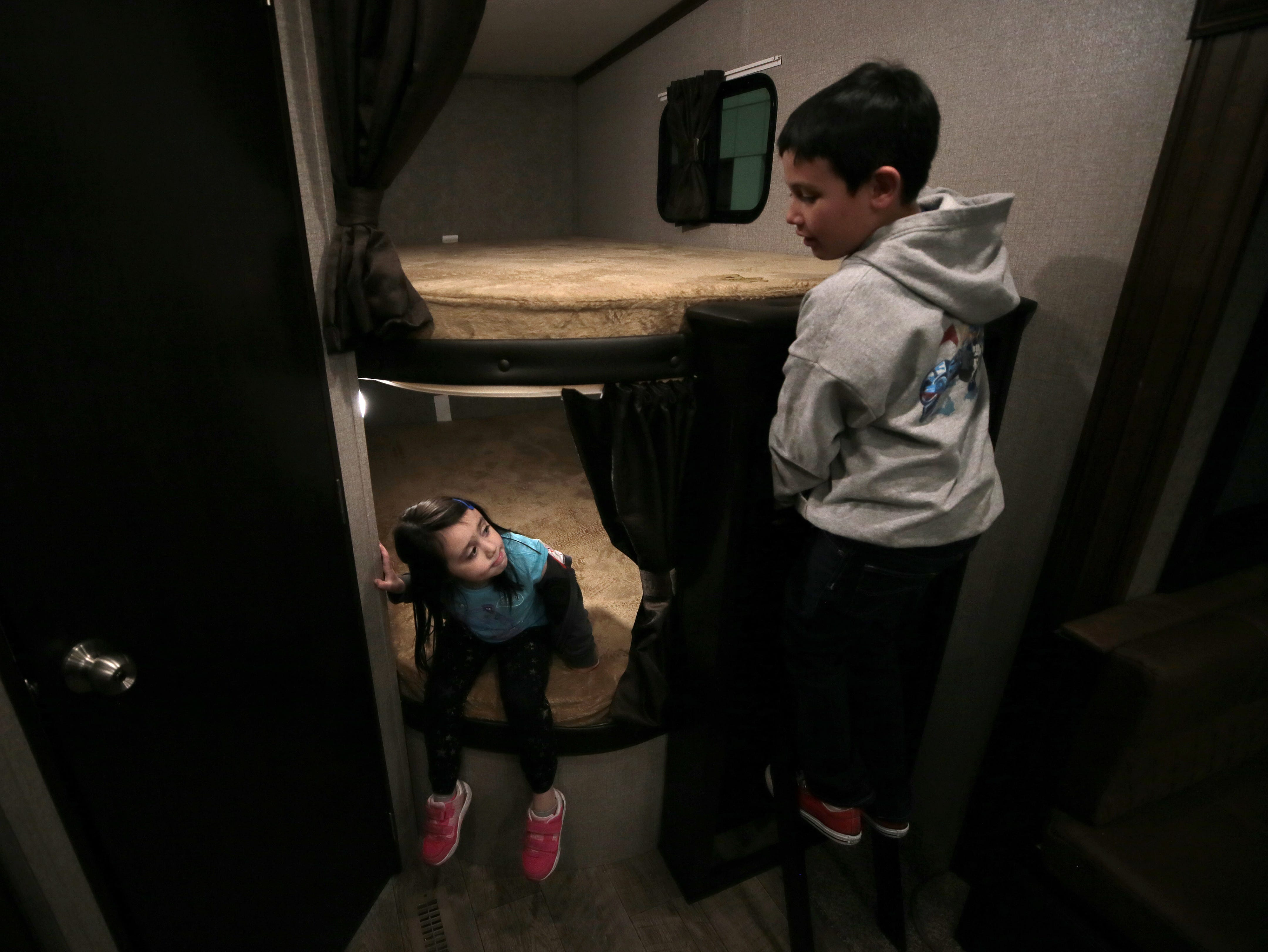 Katie and Jake Johnson play on the bunkbeds in a camper at the 2019 El Paso RV Show at the Judson F. Williams Convention Center. The show continues Saturday and Sunday.