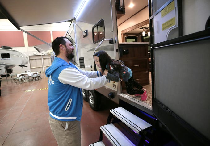Katie Johnson, 4, jumps from a camper to her dad, Matt Johnson, as they tour RVs and campers at the 2019 El Paso RV Show on Saturday, March 16, 2019, at the Judson F. Williams Convention Center. The show continues from 11 a.m. to 4 p.m. Sunday. Children 12 and younger get in free. Adult Good Sam members get in for $6. Adult tickets are $8.