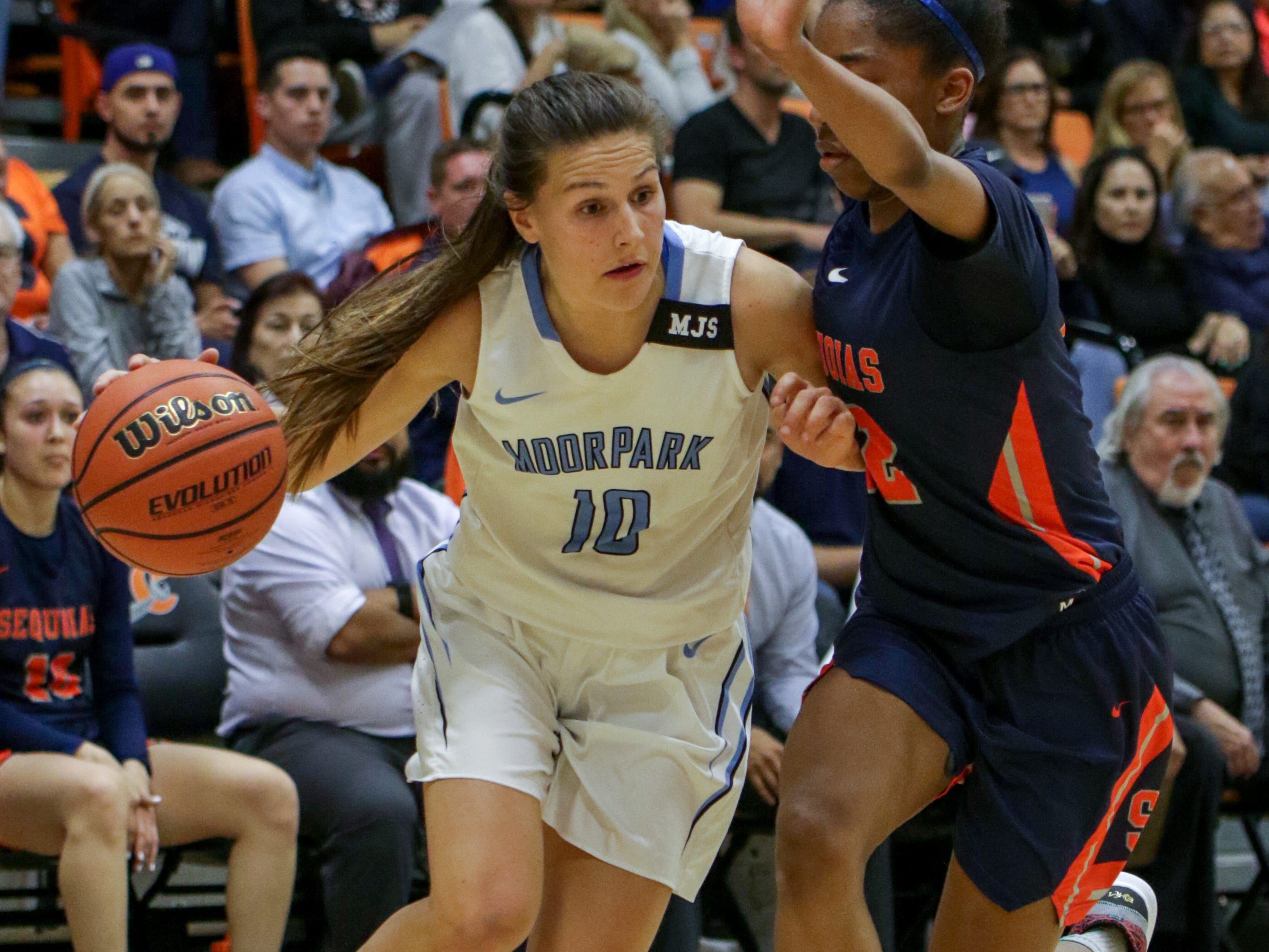 Moorpark College sophomore Emily Herring drives to the basket during the CCCAA state quarterfinal against College of the Sequoias on Friday night at Ventura College. Moorpark won, 66-58.