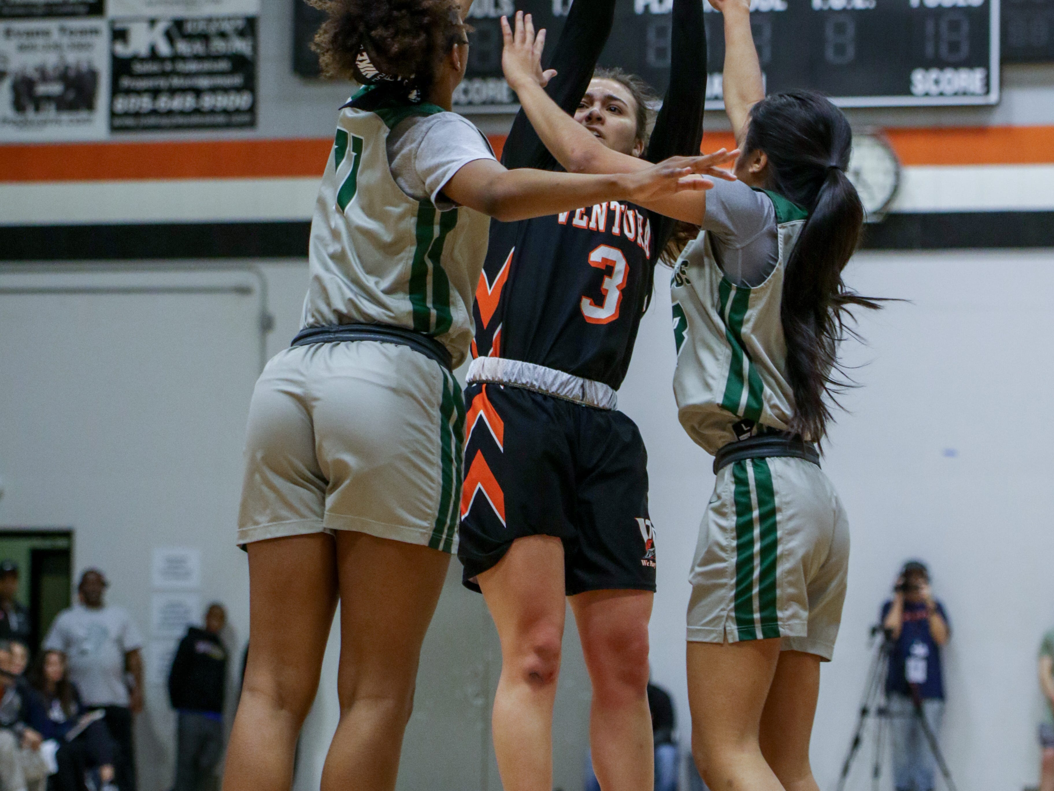 Ventura College freshman Cece Quintino is well defended by Diablo Valley's Leilani Moncrease and Jasmine Kong during the CCCAA state quarterfinals on Friday night in Ventura. Diablo Valley won, 59-57.