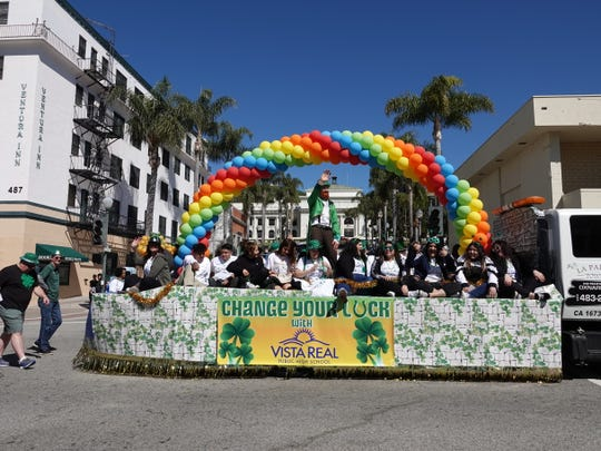 A rainbow of balloons on the Vista Real High School float frames Ventura City Hall in the distance during Saturday's St. Patrick's Day parade along Main Street.