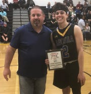 Agoura's Cyrus Sarkey, of the East team, holds his 3-point champion plaque while posing for a photo with Rio Mesa athletic director Chris Ruffinelli, the president  of the Ventura County Basketball Coaches Association.