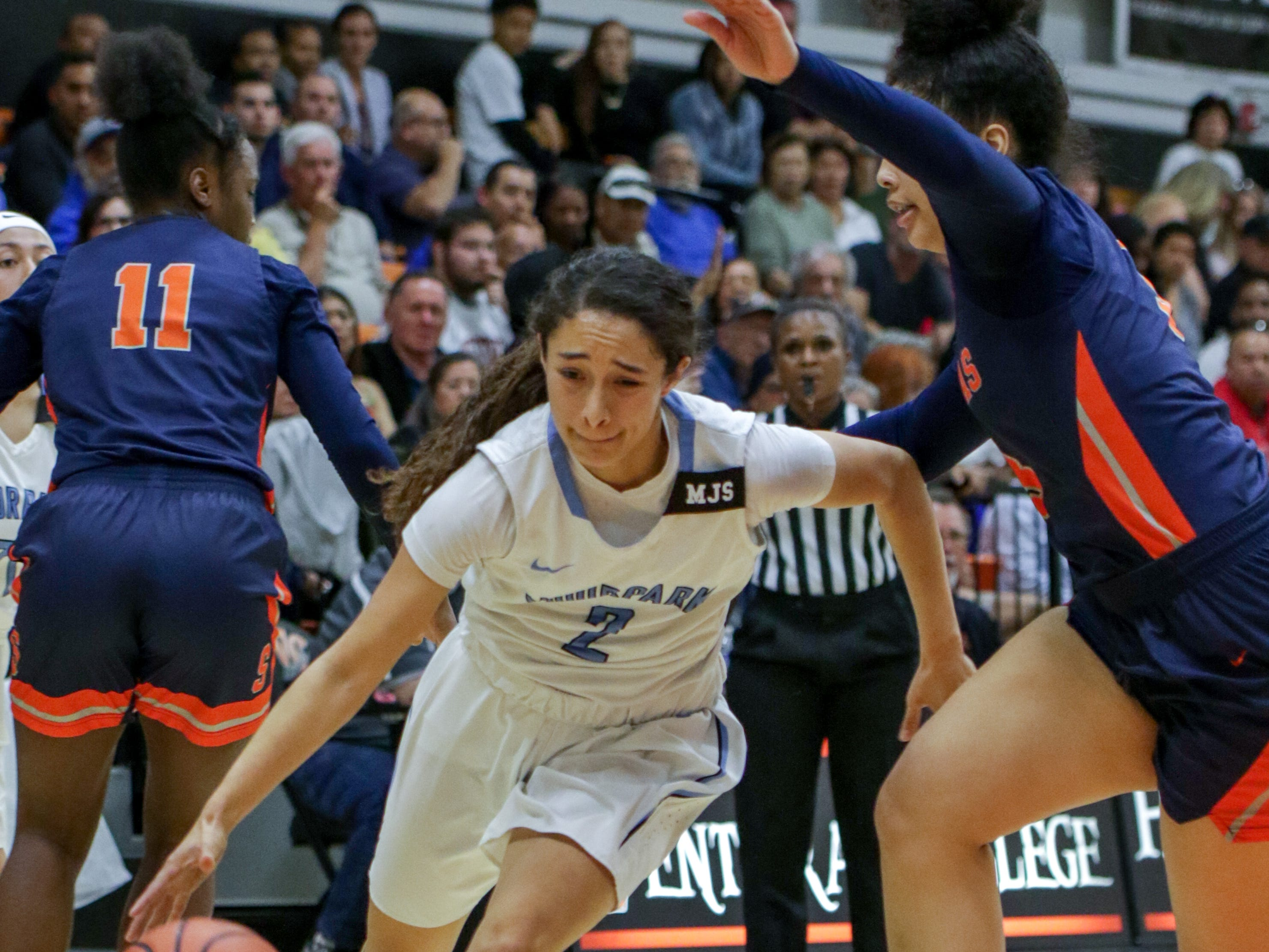 Moorpark College freshman Isabel Ayala dribbles under pressure during the CCCAA state quarterfinal against College of the Sequoias on Friday night at Ventura College. Moorpark won, 66-58.