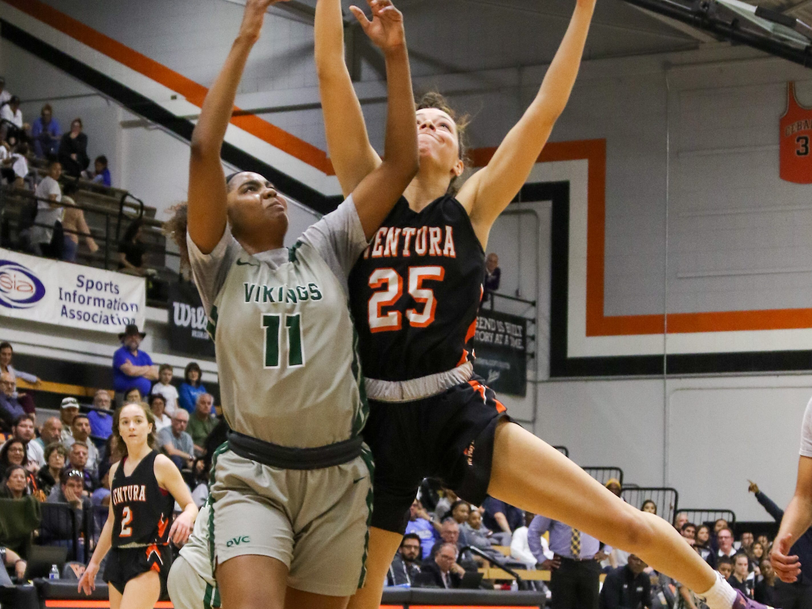 Ventura College freshman Robin Fallandy is fouled by Diablo Valley's Leilani Moncrease during the CCCAA state quarterfinals on Friday night in Ventura. Diablo Valley won, 59-57.