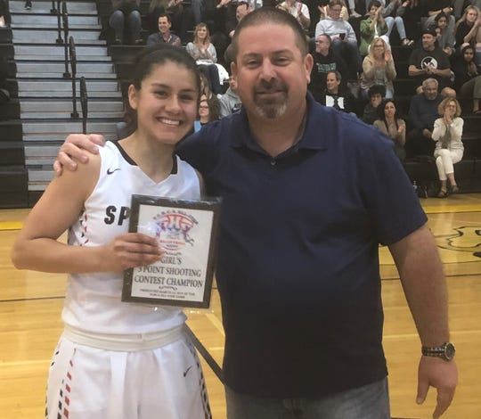 Rio Mesa's Lupita Rocha holds her 3-point champion plaque while posing for a photo with Rio Mesa athletic director Chris Ruffinelli, the president  of the Ventura County Basketball Coaches Association. Rocha won the 3-point contest and was named MVP of the girls county all-star basketball game Friday at Ventura High.