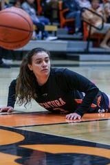 Ventura College freshman Cece Quintino picks herself off the floor during the CCCAA state quarterfinals against Diablo Valley on Friday night in Ventura. Diablo Valley won, 59-57.