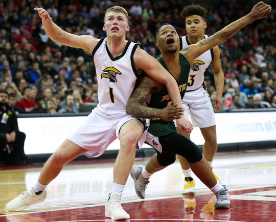 Waupun's Marcus Domask and Martin Luther's Shaun Harrison fight for rebounding position in the Division 3 boys basketball state championship game Saturday at the Kohl Center in Madison.