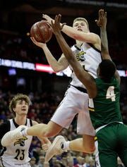 Waupun's Marcus Domask (1) goes to the basket against Martin Luther's Xzavier Jones during the WIAA Division 3 boys basketball state championship game at the Kohl Center.