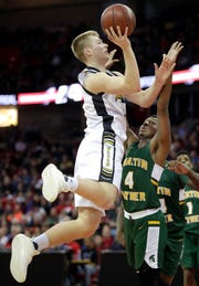 Waupun's Marcus Domask (1) shoots against Martin Luther's Xzavier Jones (4) during their WIAA Division 3 boys basketball state championship game March 16 at the Kohl Center in Madison.