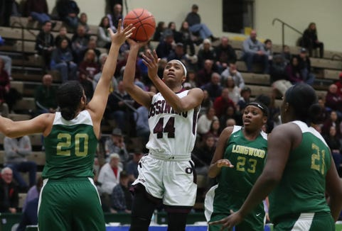 Ossining's Aubrey Griffin (44) is surrounded by Longwood defenders as she puts up a shot against Longwood during the girls Class A state semifinal at Hudson Valley Community College in Troy March 16, 2019. Ossining won the game 68-56.