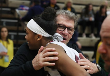 University of Connecticut coach Geno Auriemma gives Ossining's Aubrey Griffin a hug, after Ossining defeated Longwood 68-56 in the girls Class A state semifinal at Hudson Valley Community College in Troy March 16, 2019.