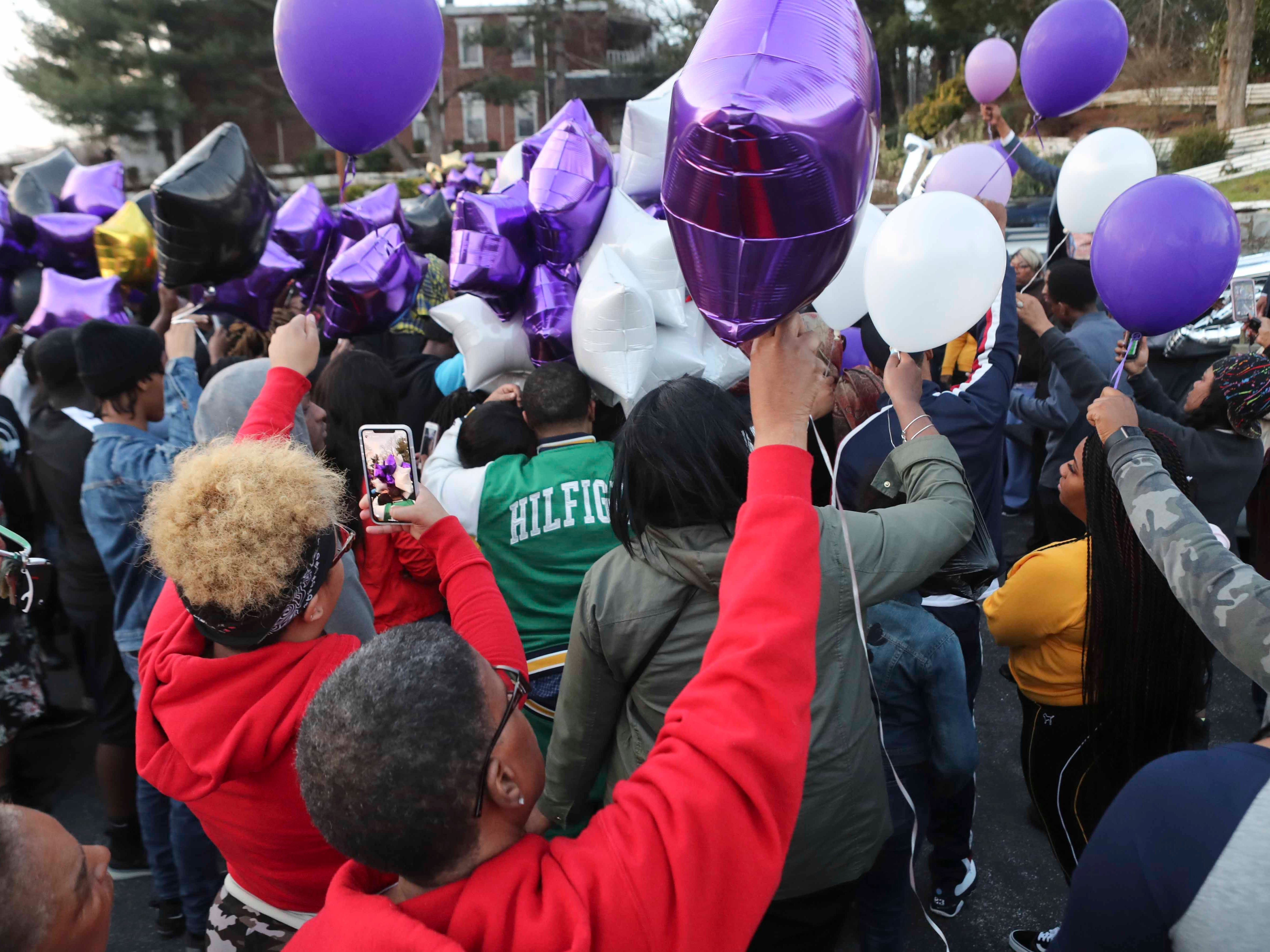 Mourners prepare to release balloons at the conclusion of a memorial gathering Friday evening for Janiya Henry in Wilmington. Henry and boyfriend Christian Coffield were killed earlier this week and left behind their 3-month-old son.