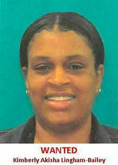 "This undated ""Wanted"" image shows Kimberly Akisha Lingham-Bailey, 37, of Philadelphia who Delaware State Police say is a suspect in a multi-state shoplifting ring that stole thousands in merchandise from high-end department stores. The Delaware State Police said in a news release Friday March 15, 2019, that warrants have been taken out charging Bailey with felony shoplifting. (The Delaware State Police via AP)"