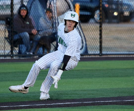 Iowa Park's Kase Johnson stops at third in the game against Benbrook Friday, March 15, 2019, in Iowa Park.