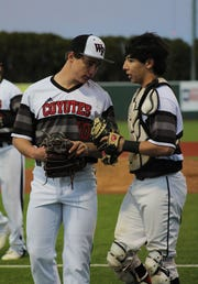 Old High catcher Nick Gonzalez gives chats with pitcher Zane Leonard after an inning. The Coyotes lost 6-2 to the Raiders Friday, March 15, 2019.