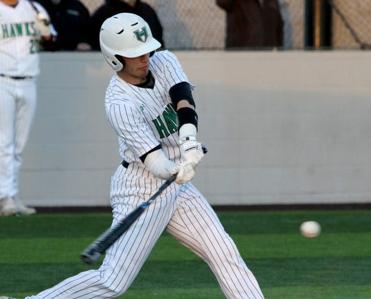 Iowa Park's Kaden Teafatiller hits a grounder against Benbrook Friday, March 15, 2019, in Iowa Park.