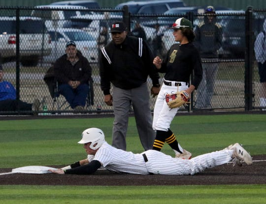 Iowa Park's Trent Green avoids a tag and makes it to third base against Benbrook Friday, March 15, 2019, in Iowa Park.